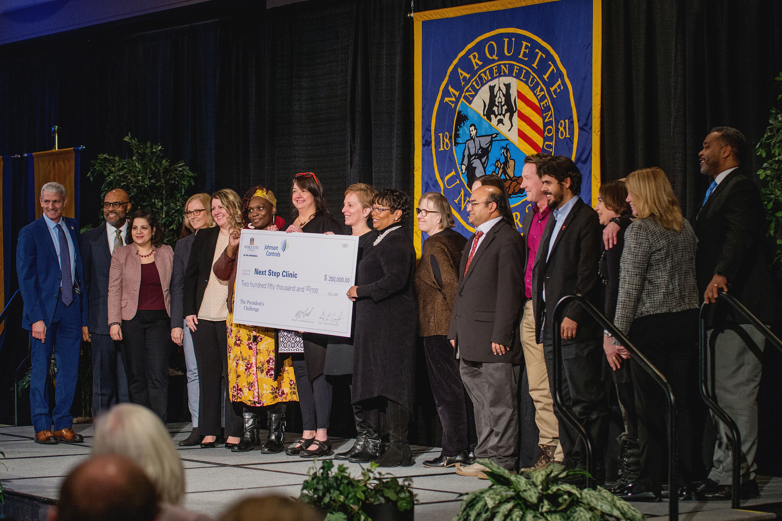 Marquette University faculty and representatives from Milwaukee community organizations pose with Marquette President Dr. Michael R. Lovell after being named winners of the President's Challenge grant (photo by Marquette University)