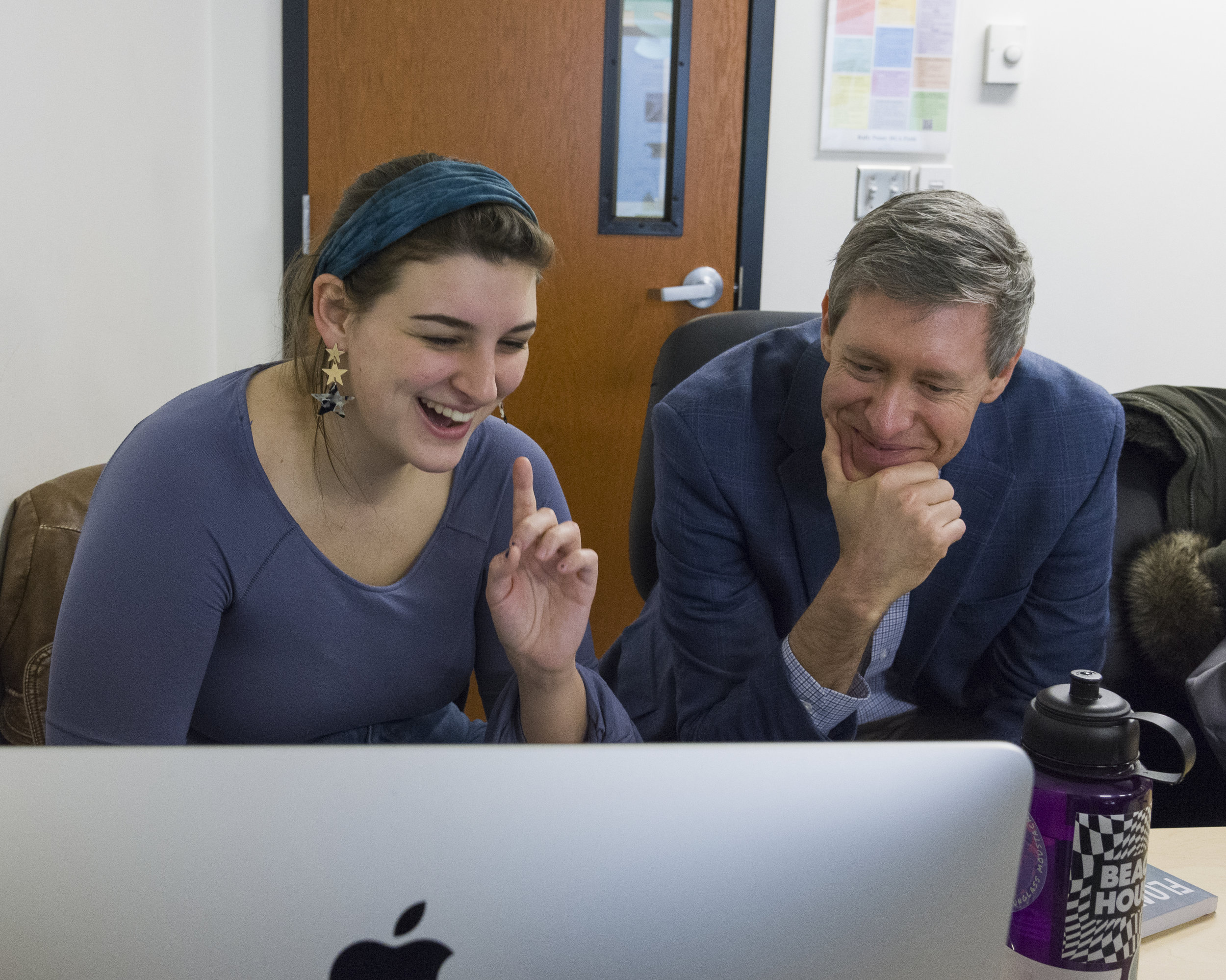 Kevin Atticks, Ph.D., director of the Apprentice House, with a Loyola student (photo by Loyola University Maryland)