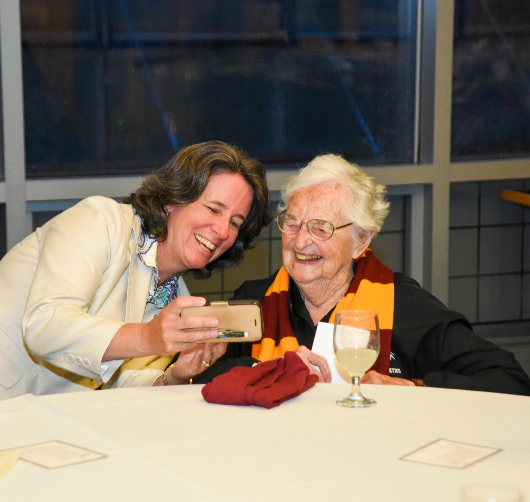 Donna Woodruff of Loyola University Maryland with Sr. Jean Schmidt (Photo by Glenn Kaupert Photography)