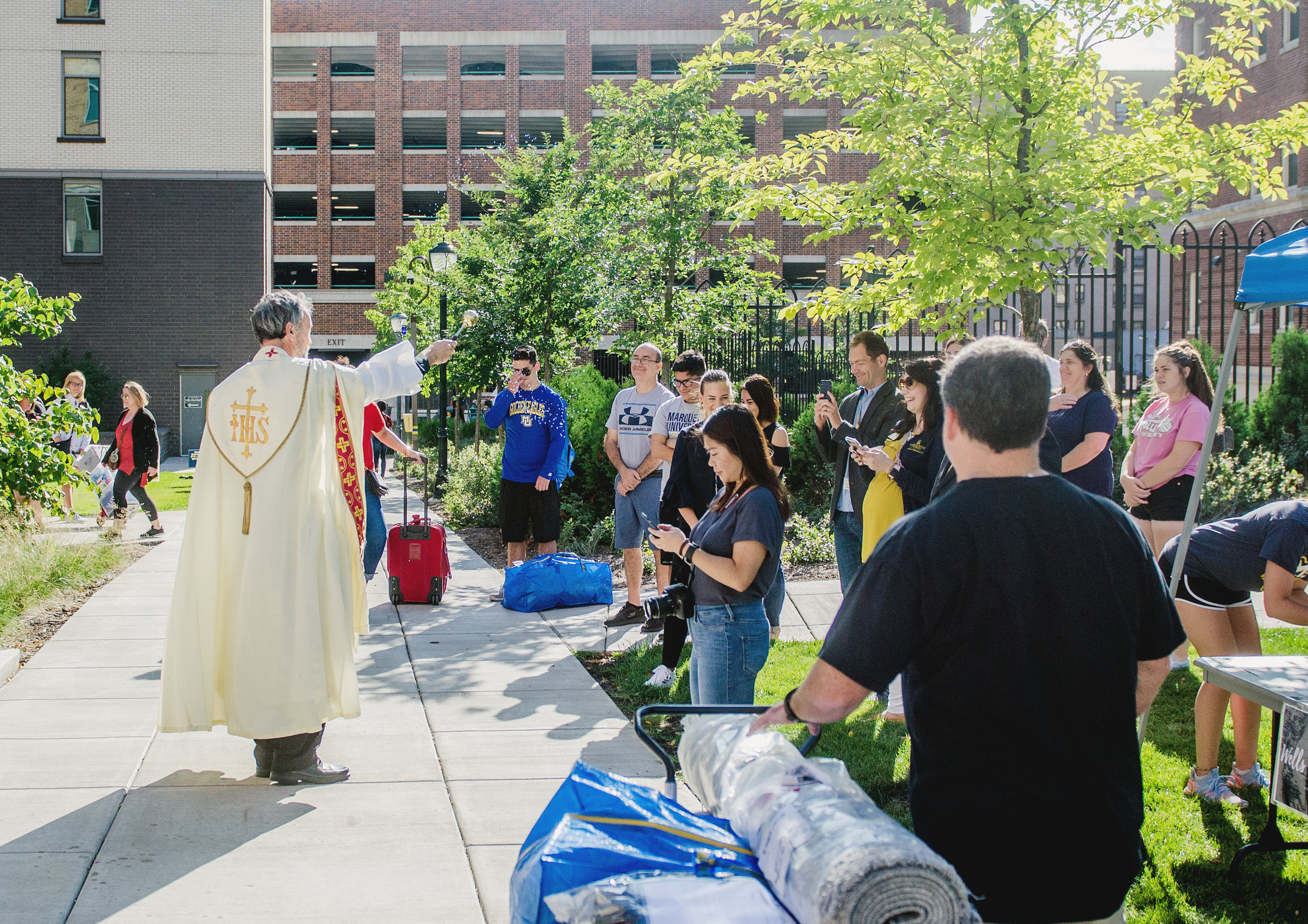Rev. Michael Maher, S.J., residence minister and associate professor of history at Marquette University, offered a blessing to new students and their families at The Commons (photo by Marquette University)