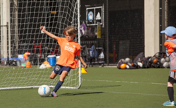 A Player at DUSC Summer camp takes his shot.