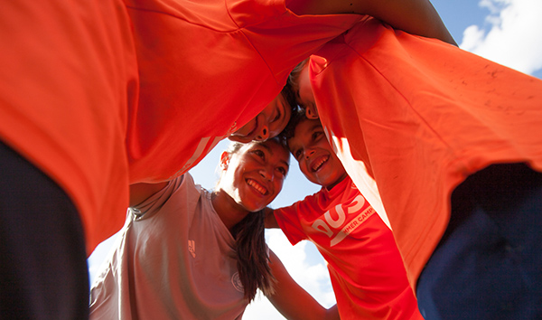 Coaches and players at DUSC Summer Camp put their heads together.