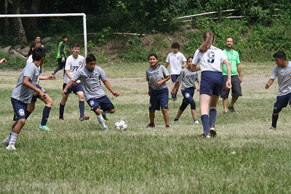 DUSC players playing with local players in Guatemala on their Soccer recycle trip.