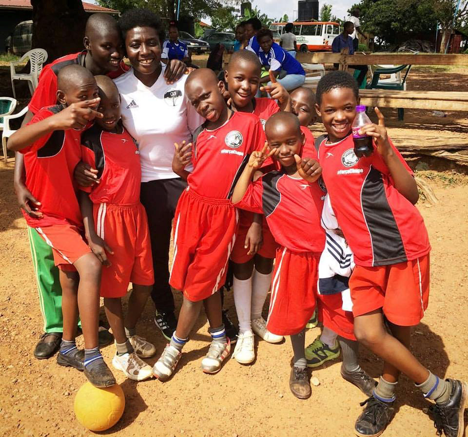 Growing the Game for Girls Co-founder, and former Uganda Women's National Team Coach, Majidah Nantanda with girls from Buguyere Deaf School.  Girls at the symposium also got snacks and sodas after they compete.