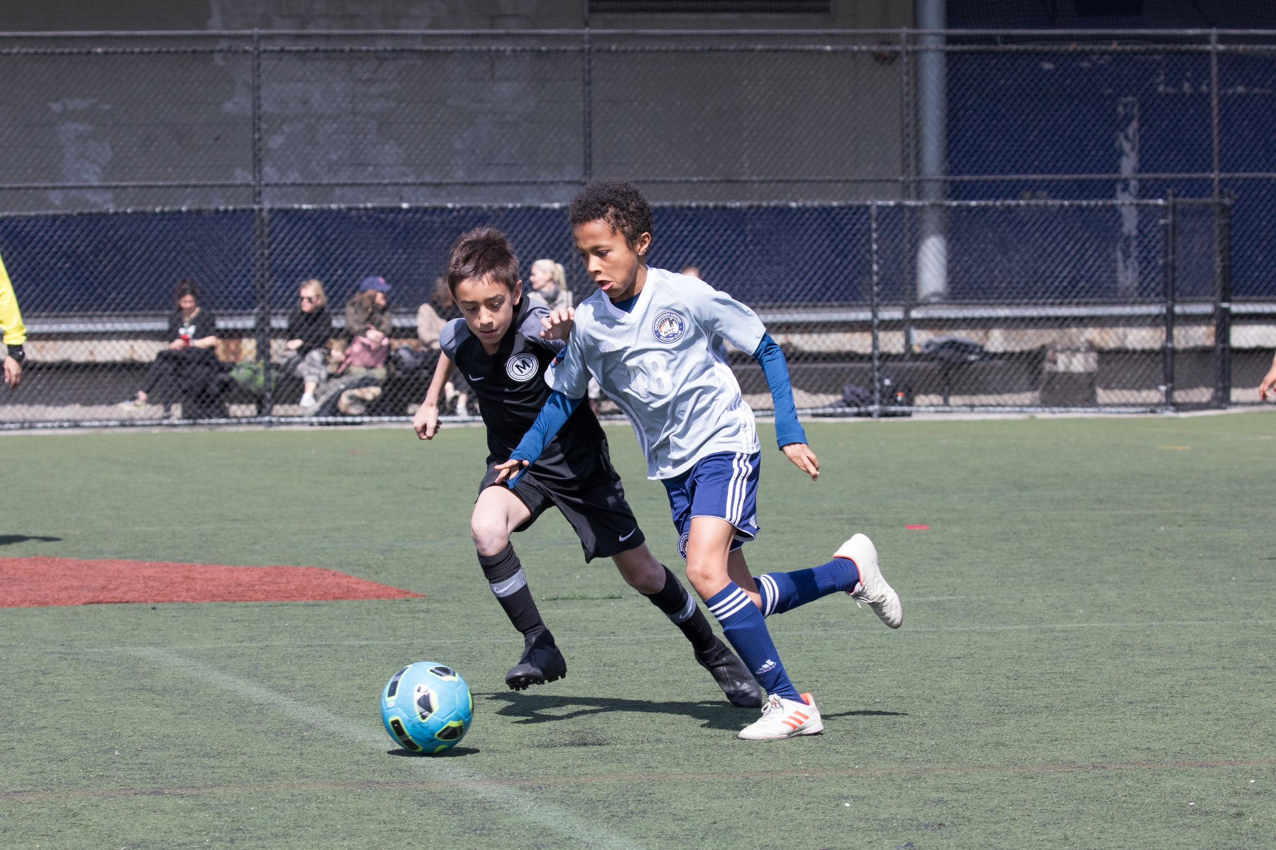 A DUSC Academy player about to pass the ball.