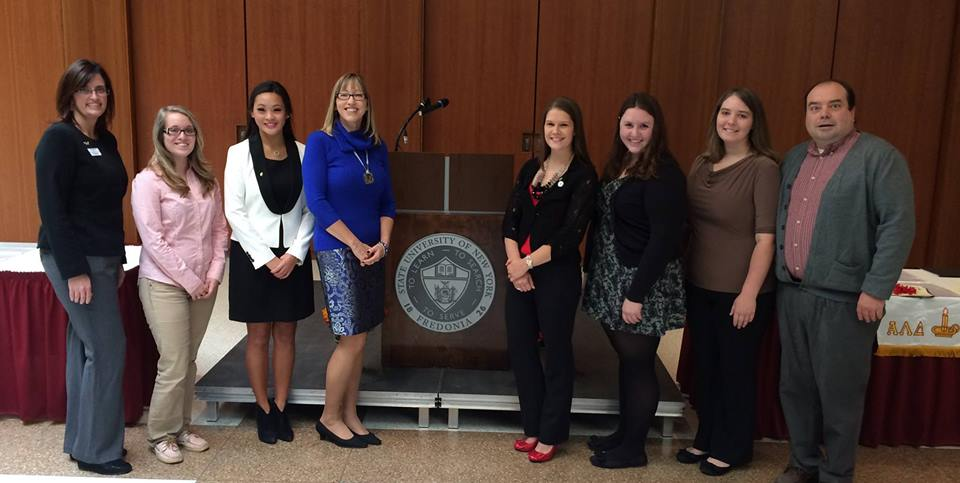 SUNY Fredonia officers and advisors pose with the executive director of alpha lambda delta