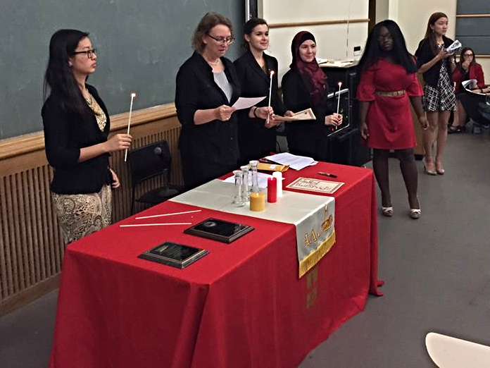 lighting the ald candles during the induction ceremony at long island university - brooklyn