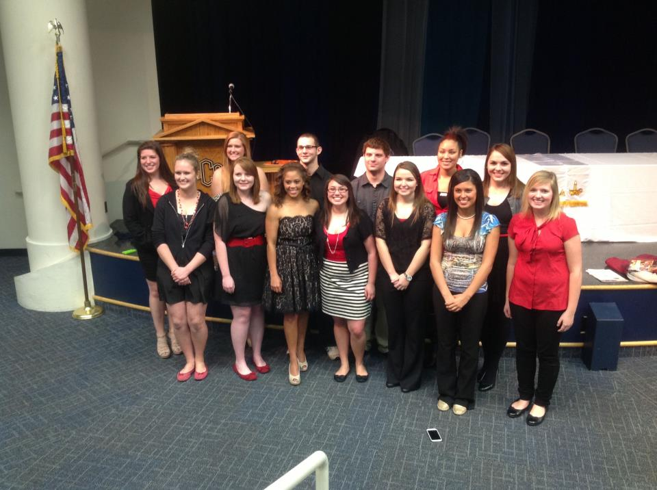 new members at the university of central oklahoma induction ceremony