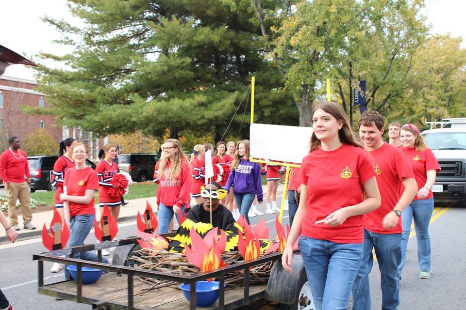 liberty university members showing their ALD pride at a homecoming parade