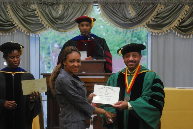 new member at norfolk state university receiving her certificate