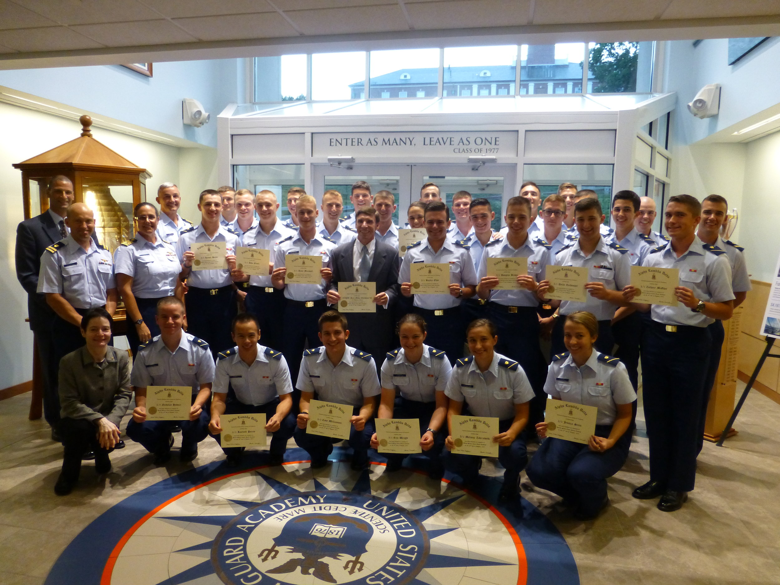 Cadets being initiated into Alpha lambda Delta at the u.s. Coast guard academy