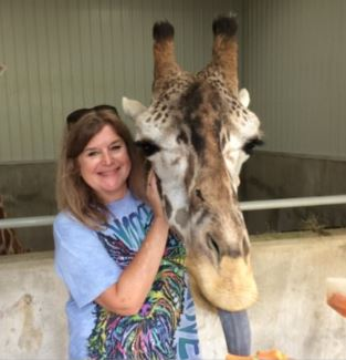 Lisa loves all animals, and visits them often!