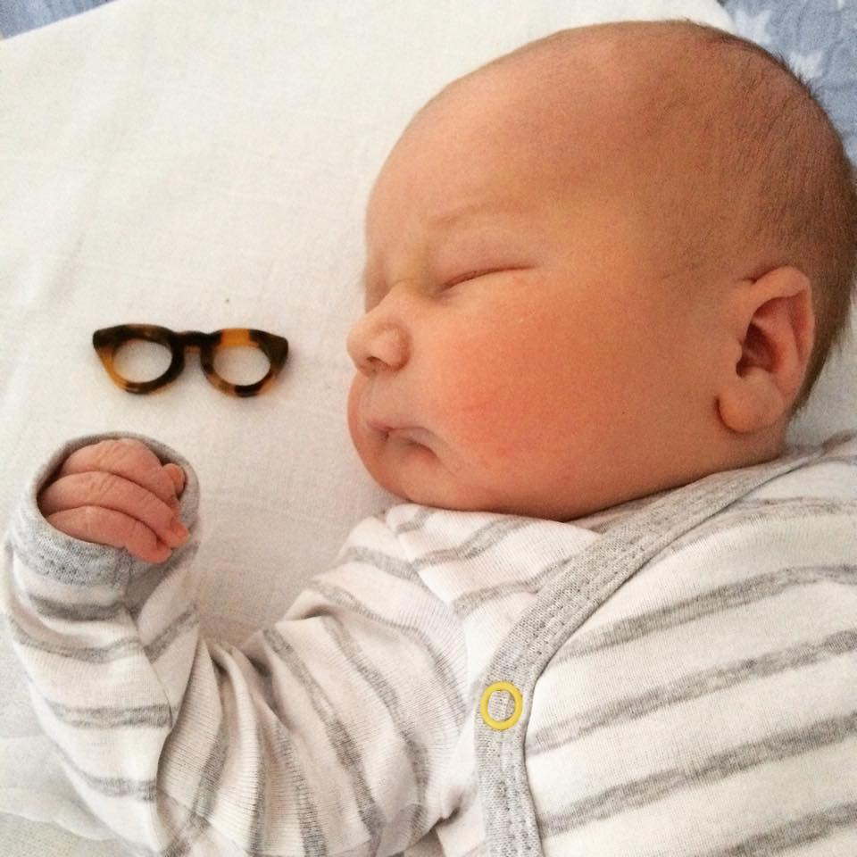 Cute little glasses with newborn