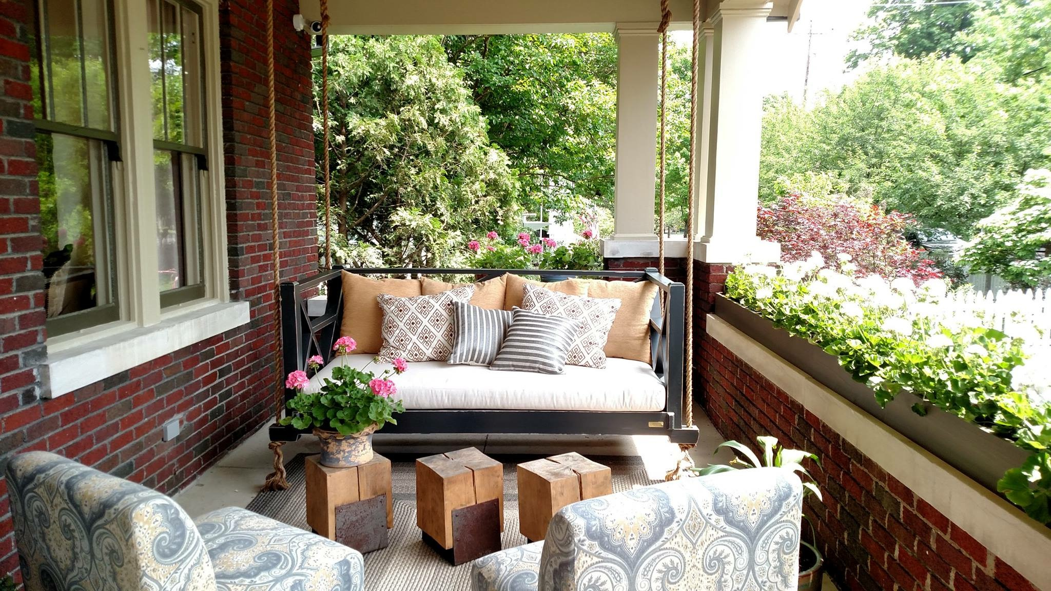 We designed the front porch of the O'More Show House as an extended living space where a family could hang out and entertain.