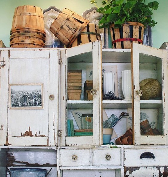In the potting shed we hung an early 1900s bakers cupboard to hold planting necessities. It's aged patina adds a time-worn feel to the space.
