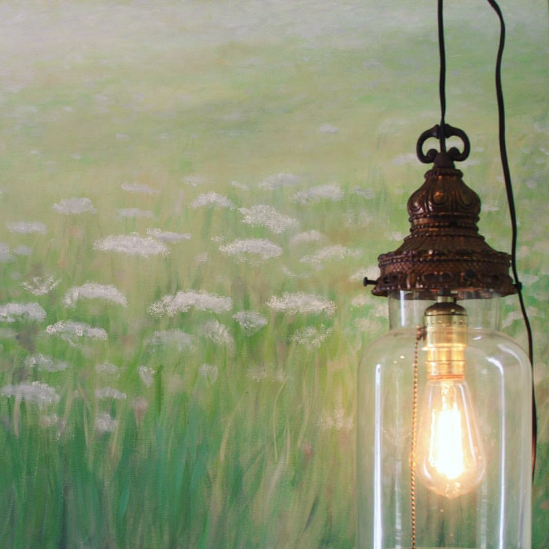 Artist Erin Anderson created a beautiful summer meadow painting to add a sophisticated flair to the gardening spot.