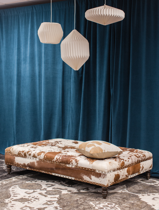 This oversized cowhide ottoman adds playfulness to the CMA Fest Green Room  | City Farmhouse Interior Design