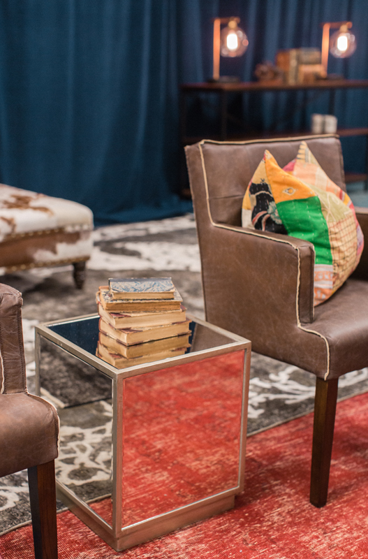 Mirrored square side tables reflect the beautiful Persian rugs throughout the CMA Fest Green Room | City Farmhouse Interior Design