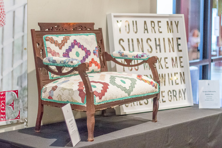 Antique bench upholstered with an old quilt | City Farmhouse Pop Up Fair