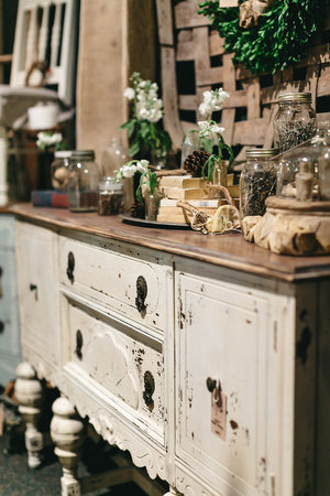 Antique dresser with chippy white paint at the November City Farmhouse Pop Up Fair