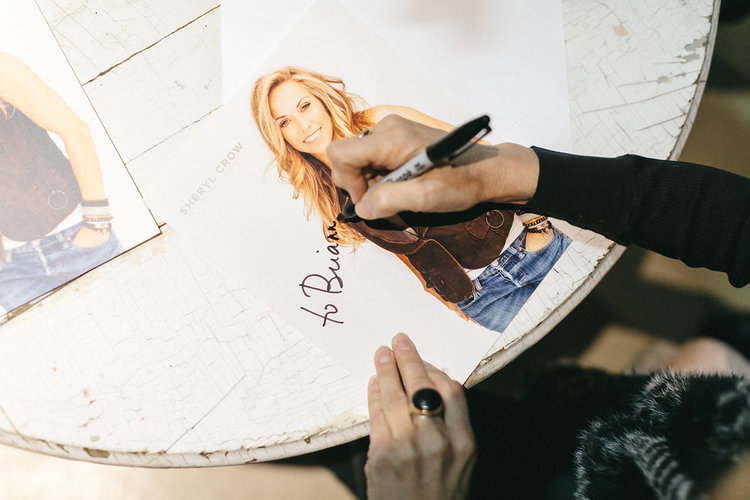 Sheryl Crow signing autographs at the November City Farmhouse Pop Up Fair