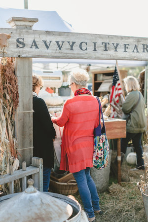 Crowd shopping the Savvy City Farmer booth