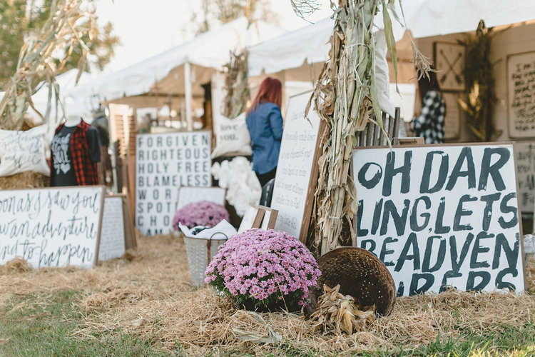 """Oh darling let's be adventurers"" sign at the City Farmhouse Pop Up Fair"