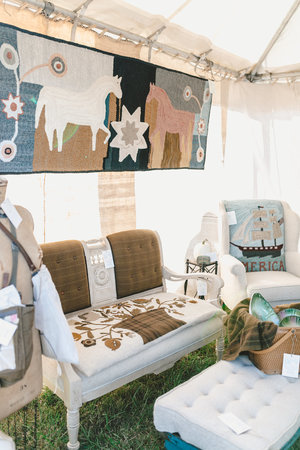 Eclectic vintage couch and quilt at the City Farmhouse Pop Up Fair | Franklin, TN