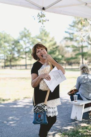 Chowing down on popcorn at the City Farmhouse Pop Up Fair | Franklin, TN