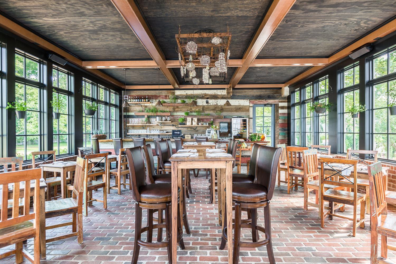 Homestead Manor has a sleek modern bar filled with natural woods and masculine details. | Interior Design: Kim Leggett | Photographer: Alyssa Rosenheck