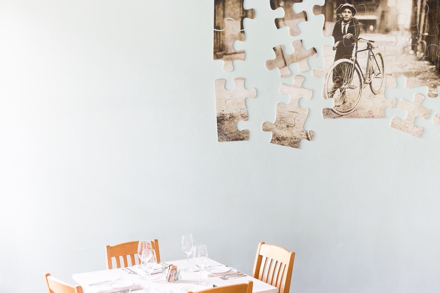 A puzzle with pieces scaling the wall at Homestead Manor | Interior Design: Kim Leggett | Photographer: Alyssa Rosenheck