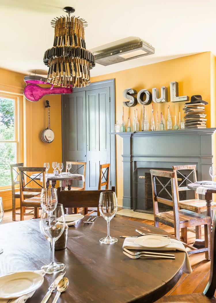 "Metal letters spelling ""soul"" in the yellow room at Homestead Manor | Interior Design: Kim Leggett | Photographer: Alyssa Rosenheck"