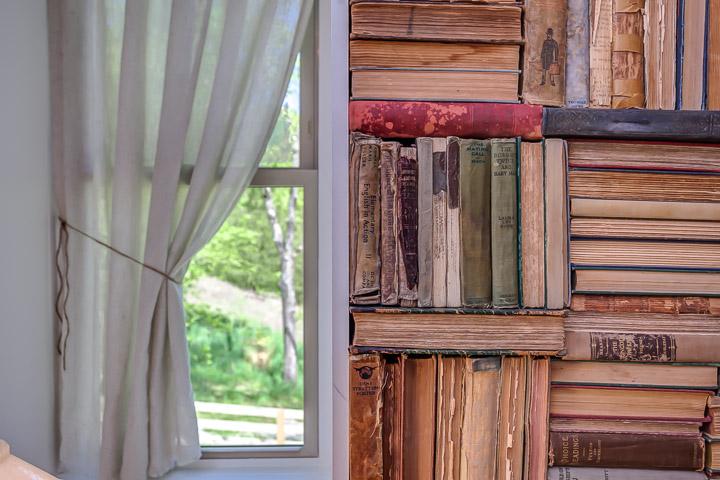 Closeup of the vintage book wall at the Nest | Interior Designer: Kim Leggett