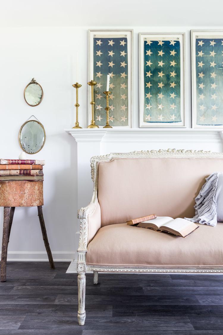 Charming vintage pink sofa in the living room at One King's Lane   Photography: Alyssa Rosenheck   Interior Design: Kim Leggett