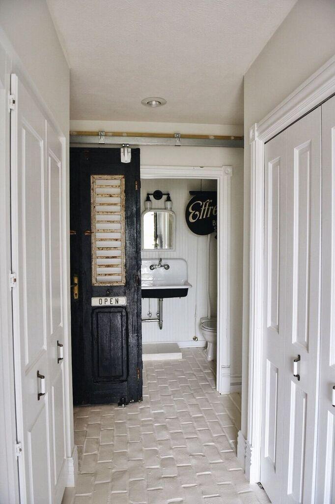White subway tiles run the length of the farmhouse style bathroom on the Liz Marie Blog