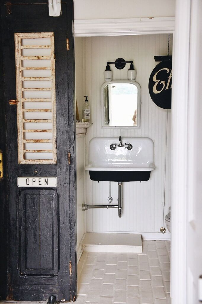 Farmhouse Style bathroom filled with antiques on the Liz Marie Blog