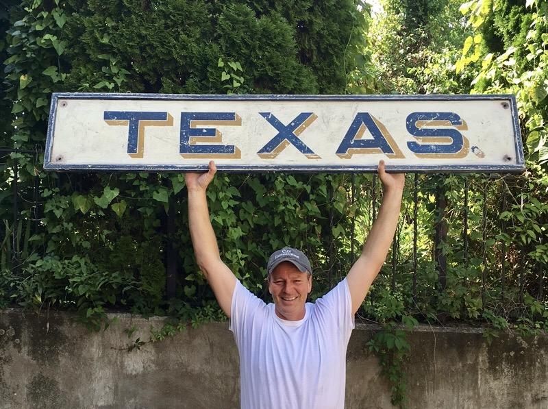 David holding Texas sign