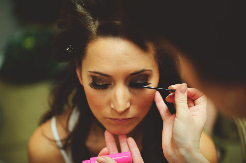 hollis garden wedding: bride getting make up done