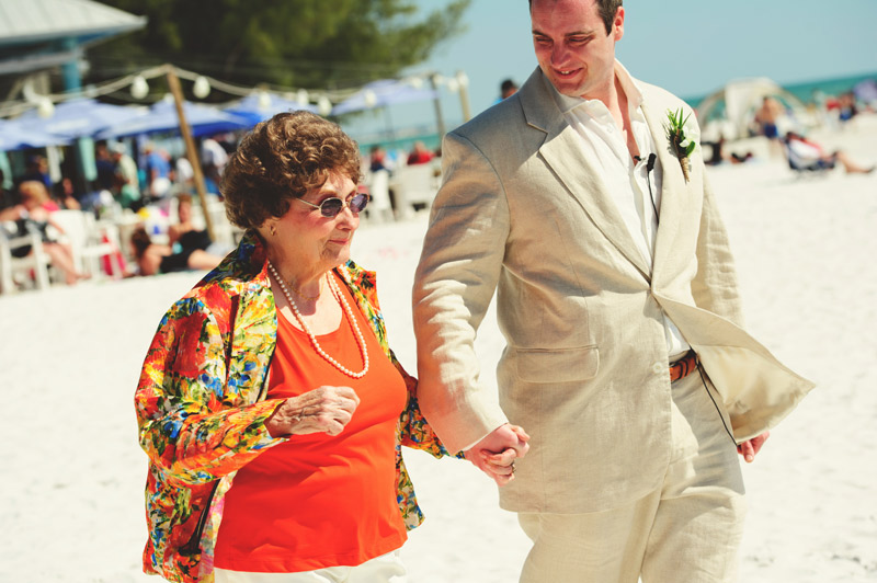 anna maria island wedding: grandmother walking groom down aisle