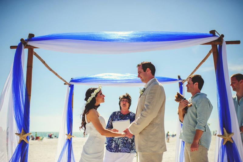 anna maria island wedding: bride and groom saying vows