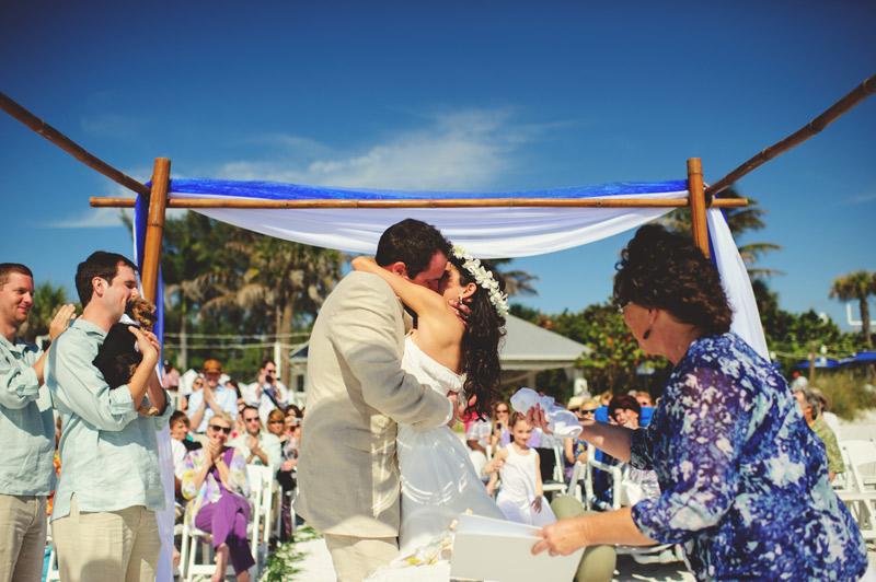 anna maria island wedding: first kiss
