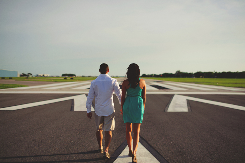 romantic airport engagement session: walking on runway