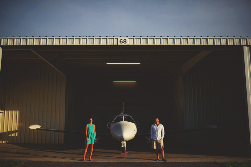 romantic airport engagement session: airplane hanger