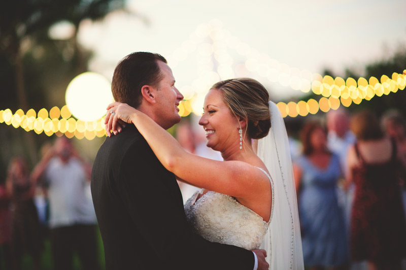naples backyard beach wedding: groom and bride first dance