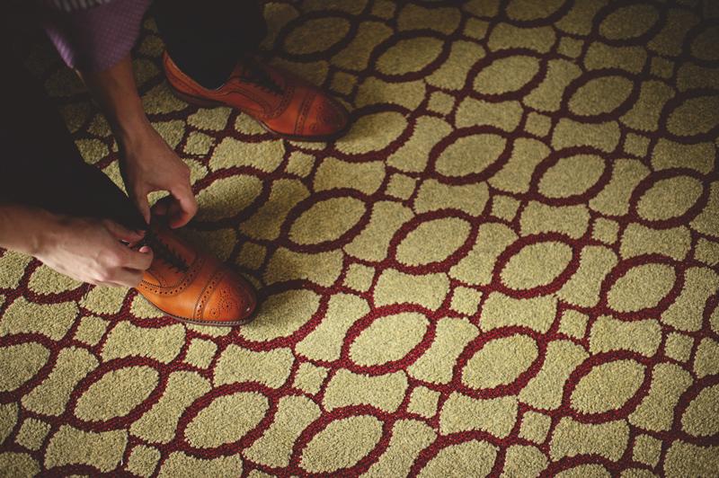 st pete elopement:  groom tying allen edmond shoes