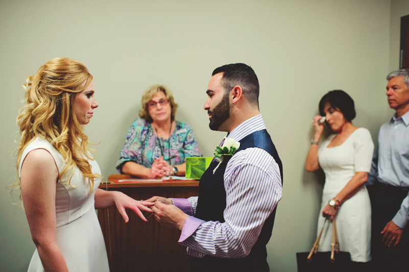 st pete elopement:  groom putting ring on bride