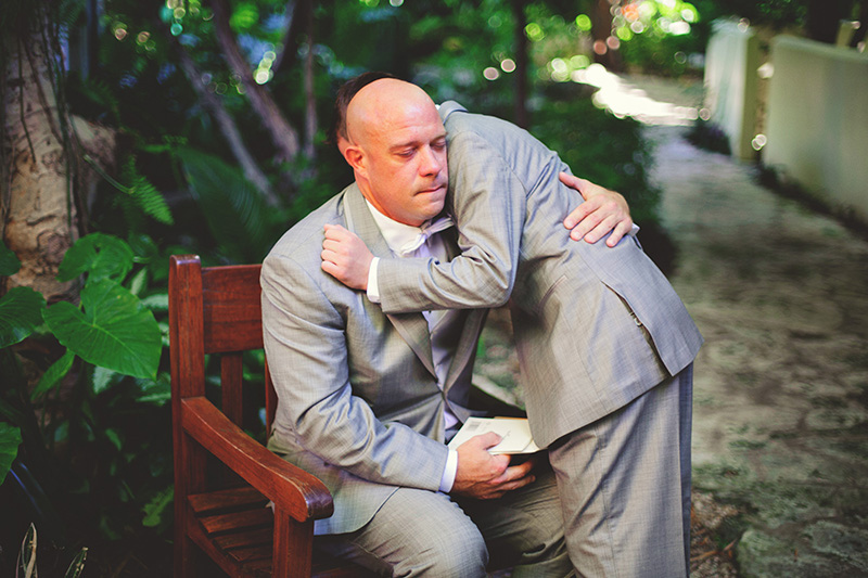 romantic sundy house wedding: groom and son hugging