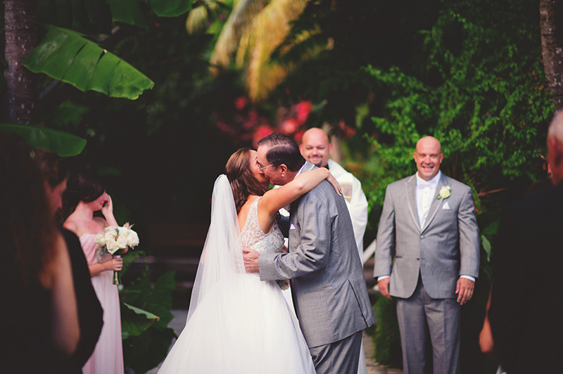 romantic sundy house wedding: dad kissing bride
