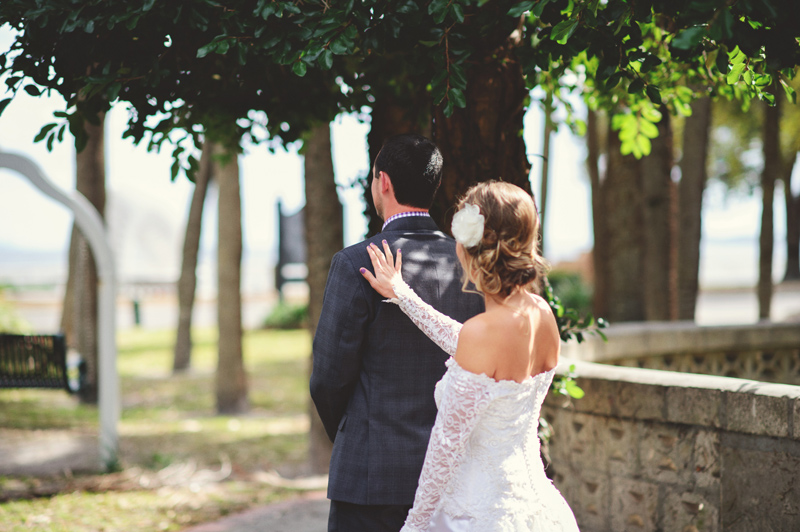 backyard wedding tampa:  bride tapping groom on shoulder