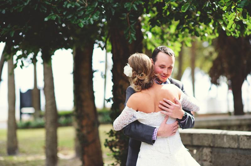 backyard wedding tampa: groom hugging bride